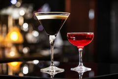 Manhattan and espresso cocktails in elegant glasses at colorful stock photography