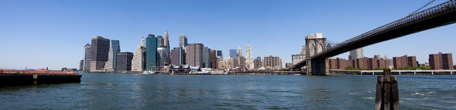 Manhattan Financial District. Panorama of the Financial District, South Street Sea Port and Battery park in Manhattan, New York City, under a deep blue sky on a Stock Photo