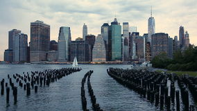 Manhattan Financial District skyline from Brooklyn Bridge Park stock footage