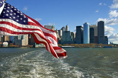 Manhattan and Flag Stock Photography