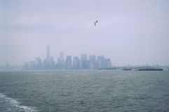 Manhattan in the fog. The Manhattan Island in the fog. View from the Staten Island Ferry Royalty Free Stock Images