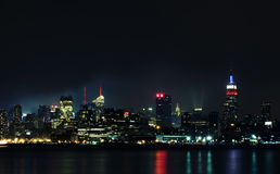Manhattan from Hudson river at night Royalty Free Stock Image