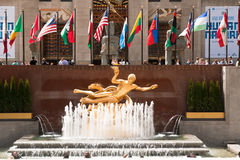 Manhattan icons, New York City, USA. New York, USA, May 7, 2013. Prometheus Statue in the front of Rockefeller Center building with the famous flags of different Stock Photos