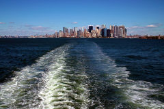 Manhattan Island, New York USA. New York Lower Manhattan and Financial District viewed over the wake of a departing Staten Island Ferry stock photo