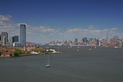 Manhattan and Jersey skyline. Under a beautiful blue sky Stock Images