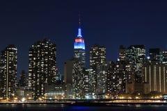 Manhattan linia horyzontu Przy nocą, Miasto Nowy Jork Obrazy Royalty Free