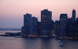 Manhattan, Long Island. This is a shot of Manhattan New York. The sky carried a purplish/pink color. The sunset behind the buildings provided the color. The Stock Photography
