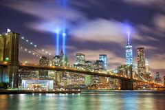Manhattan in memory of September 11. Manhattan skyline with Brooklyn Bridge and the Towers of Lights (Tribute in Light) in New York City Royalty Free Stock Photo