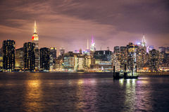 Manhattan midtown skyline with skyscrapers buildings at night, New York City stock photography