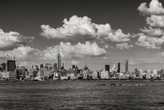 Manhattan Midtown West skyline in Black & White with skyscrapers and clouds in Summer. New York City Royalty Free Stock Photography