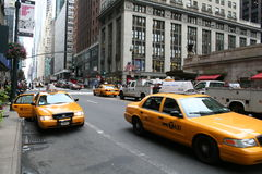 Manhattan New York City 42nd street. Typical yellow cabs in Manhattan New York City 42nd street royalty free stock image