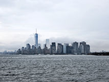 Manhattan new york city on a cloudy day. Manhattan skyline on a cloudy day from the Hudson river in New York city NY Royalty Free Stock Photos