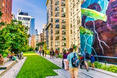 The High Line Park in Manhattan New York. The urban park is popular by locals and tourists. Manhattan, New York City - June 14, 2017: The High Line Park in royalty free stock photography