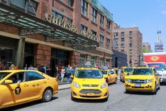 NYC Landmark, Building of Chelsea Market with yellow cap (TAXI) stock image