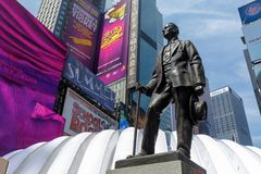 The statue of George m. Cohan with Street signs at Times Square, NYC. Manhattan, New York City - May 10, 2018 : The statue of George m. Cohan with Street signs Stock Images