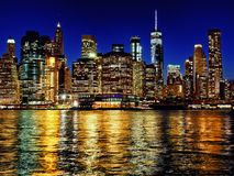 Manhattan new york city skyline at dusk from brooklyn side. Manhattan new york city usa skyline at dusk from brooklyn side royalty free stock images