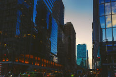 Manhattan New York street featuring skyscapers Royalty Free Stock Photos