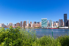 Manhattan New York sunny skyline East River NYC Royalty Free Stock Photos