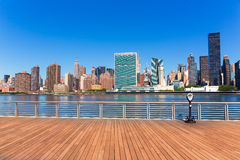 Manhattan New York sunny skyline East River NYC Royalty Free Stock Images