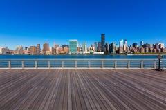 Manhattan New York sunny skyline East River NYC Royalty Free Stock Photos