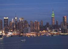 Manhattan at Night. This is a wide view of the New York City skyline just after dark royalty free stock photo