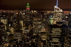 Manhattan by night. Manhattan's skyscrapers at night. The Empire State Building is lit up for Christmas (red and green lights Royalty Free Stock Photo