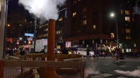 Manhattan night city scene intersection with exhaust pipe