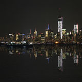 Manhattan at night, New York City skyline with reflection in Hudson River Stock Photo