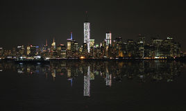 Manhattan at night, New York City skyline with reflection Royalty Free Stock Photography