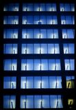 Manhattan Office Building. This image was shot in Lower Manhattan, New York City, New York and shows repeated pattern of fluorescent office lights and windows Stock Images