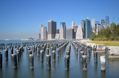 Manhattan. Old pier pylons and Downtown Manhattan, New York City Royalty Free Stock Image