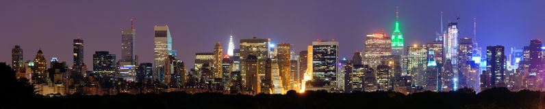 Manhattan Panorama. Panorama of midtown Manhattan at night in New York City Stock Photos