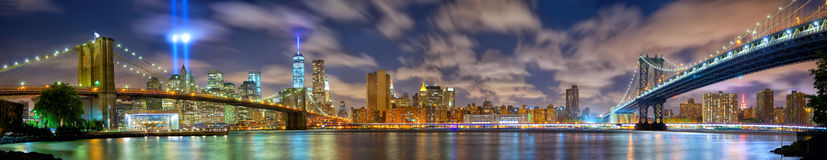 Manhattan panorama in memory of September 11. Lower Manhattan skyline panorama with the Towers of Lights (Tribute in Light) in New York City Stock Photos