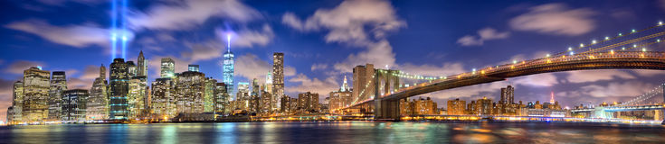 Manhattan panorama in memory of September 11. Manhattan skyline panorama with the Towers of Lights (Tribute in Light) in New York City Stock Photography