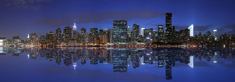 Manhattan panoramic. And reflection at twilight Royalty Free Stock Images