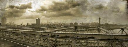 Manhattan Panoramic on grunge. Panoramic view of Manhattan taken from the Brooklyn bridge, on grunge sepia background Stock Image