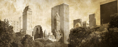 Manhattan Panoramic on grunge. Panoramic view of Manhattan taken from   Central Park, on a grunge sepia background Royalty Free Stock Photo