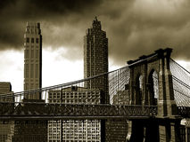 Manhattan retro. View from the Brooklyn bridge, inspired on the Manhattan skyline in the middle of the twentieth century, on a  sepia bacgkground Royalty Free Stock Images