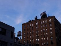 View of New York City rooftops with water tanks stock photos