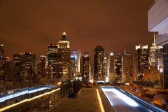 Manhattan from rooftop. View of Manhattan New York from a rooftop lounge Royalty Free Stock Photo