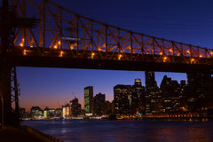 Manhattan and Roosevelt Island bridge at night in New York, USA. Royalty Free Stock Image