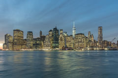 Manhattan`s Financial district, NYC. View of Manhattan`s Financial district at dusk from the Brooklyn Bridge Park, New York City Stock Image