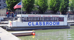 Manhattan Sailing School. Is located at North Cove Marina at Battery Park in Manhattan, NY.  It provides basic and advanced sailing classes Stock Photo