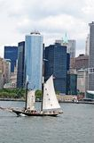 Manhattan and the ship. A view of manhattan building in new york with a beautiful ship royalty free stock image