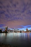 Manhattan skyline. And Brooklyn Bridge under a beautiful nighttime sky Royalty Free Stock Photos