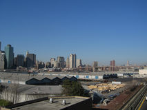 Manhattan skyline. Manhattan or New York City skyline and Brooklyn Bridge from a waterfront and warehouse perspective stock images