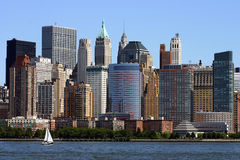 Manhattan Skyline. Taken from Battery Park with a salboat in the foreground Stock Images