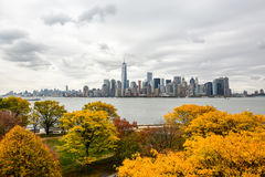 Manhattan skyline with Autumn trees. From the Liberty Island Stock Image