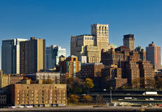 Manhattan skyline from bay on sunny day. With blue sky Royalty Free Stock Photography