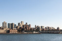 Manhattan skyline from bay on sunny day with copyspace Royalty Free Stock Photography